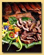 Offering wood smoked BBQ meats including Roasted Whole Hogs, Pulled Pork and Baby Back Ribs.